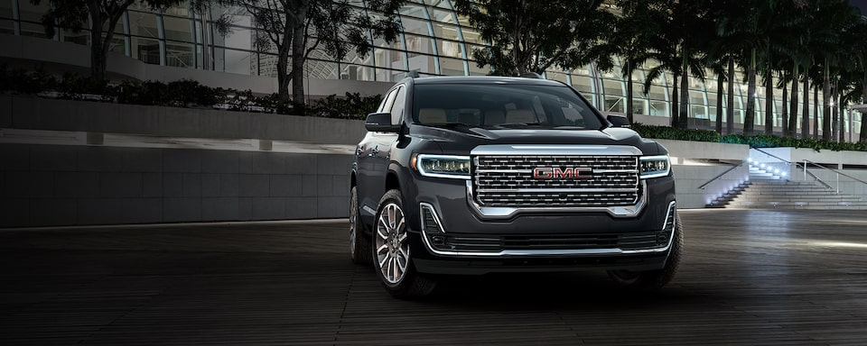 2021 GMC Acadia Denali Mid-Size Luxury SUV front angle exterior view driving on road