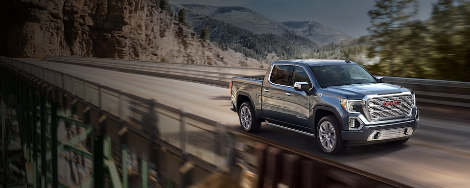 2021 GMC Sierra 1500 Denali Luxury Truck driving on bridge