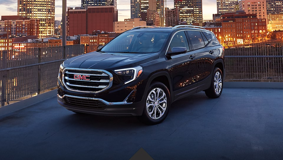 2021 GMC Terrain SLT Elevation Edition Small SUV parked with headlights on