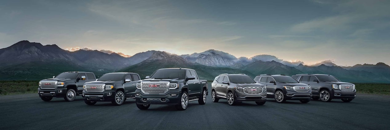 Homepage image for GMC featuring the lineup of trucks and SUVs.