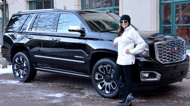 Image of Allison Fannin posing with the 2018 GMC Yukon Denali.