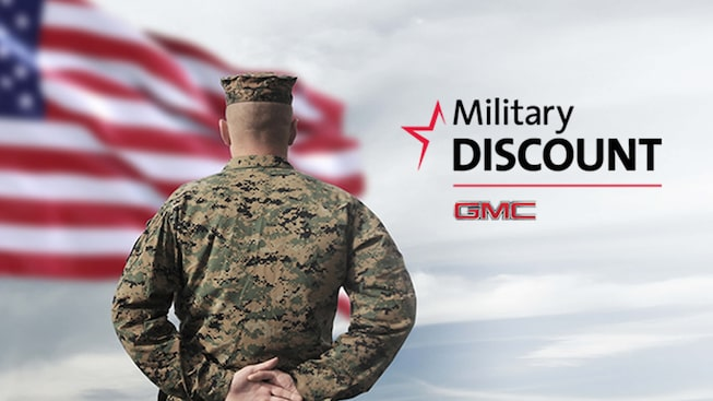 Promotile for GMC Military Discount showing a man in military uniform in front of a the American flag.