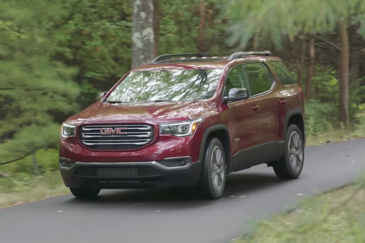 GMC life acadia in acadia driving in forest.