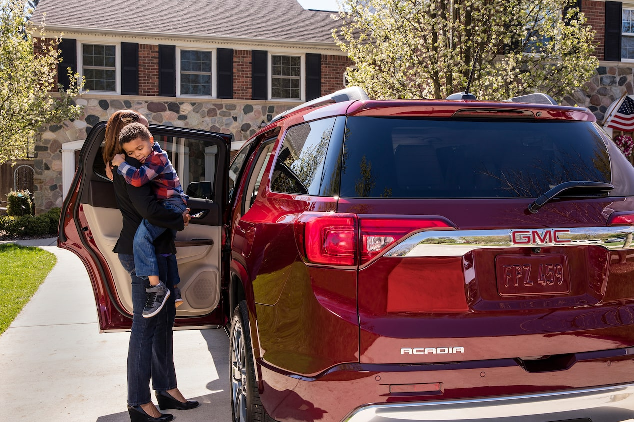 GMC life acadia rear seat reminder mom with son.