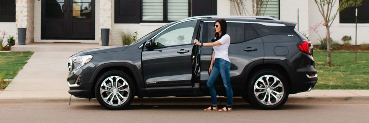 Exterior image of Allison Fannin getting in the of the 2018 GMC Terrain.
