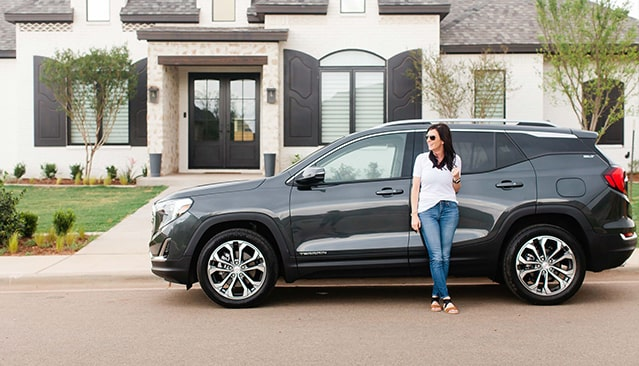 Exterior image of Allison Fannin leaning on the of the 2018 GMC Terrain.
