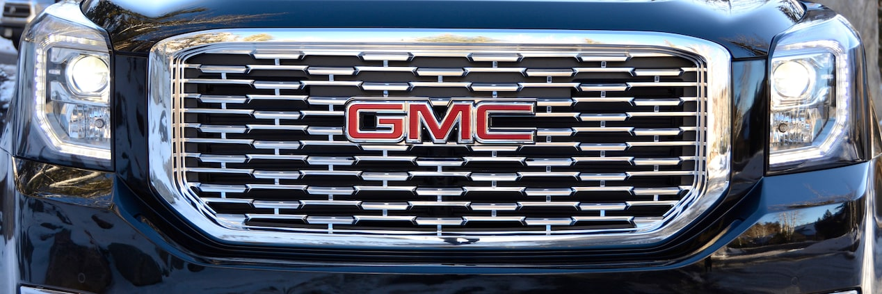 Image of the grille on the 2018 GMC Yukon Denali full-size luxury SUV.