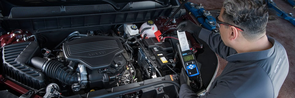 Certified GMC technician checking battery health