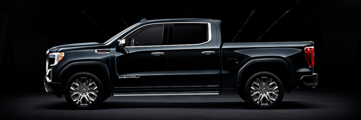 Side view photo of the next generation 2019 GMC Sierra 1500 light-duty pickup truck.