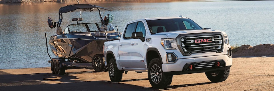 GMC Sierra 1500 AT4 off-road truck towing a Nautique Boat