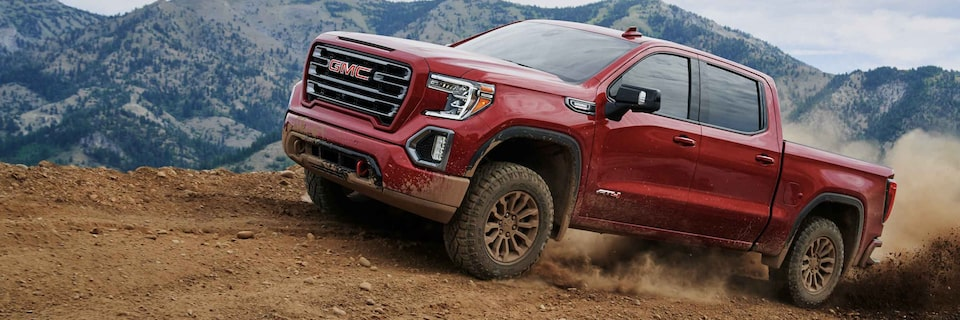 2021 GMC Sierra Truck driving on dirt
