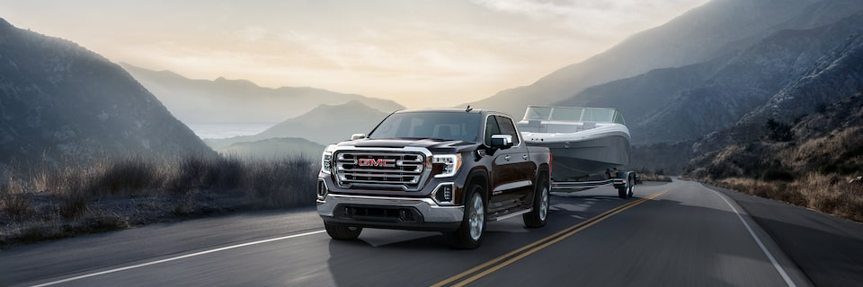 Photo of the next generation 2019 GMC Sierra 1500 light-duty pickup truck trailering a boat.
