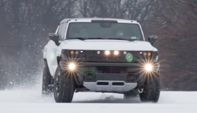 GMC HUMMER EV Electric Truck Driving on snow