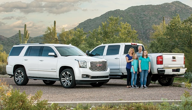 GMC Sierra HD 2500 Denali and GMC Yukon Denali  with Family