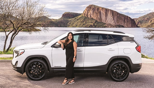 Owner with her GMC Terrain small SUV