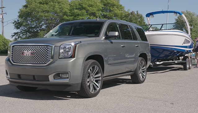Image of the 2018 GMC Yukon towing a boat.