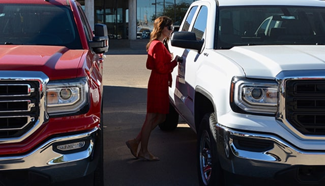 Allison Fannin shopping at a GMC Dealer for a Sierra Denali truck.