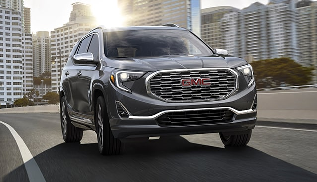 GMC Terrain Small SUV driving on road
