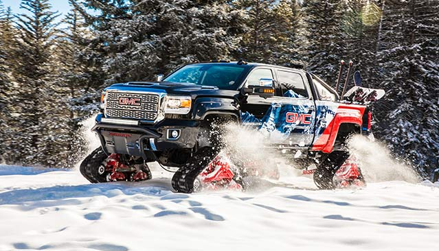 Photo showing the GMC Sierra Denali HD All Mountain Concept truck driving through the snow at Vail.