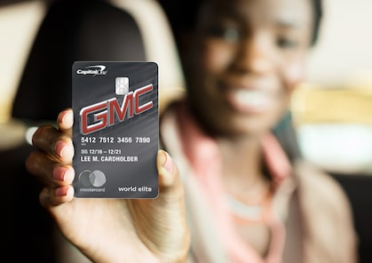 Image of the GMC BuyPower Card being held by a person with the card in focus.