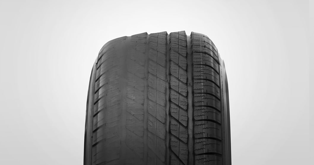 Toe tire wear example from GMC Certified Service