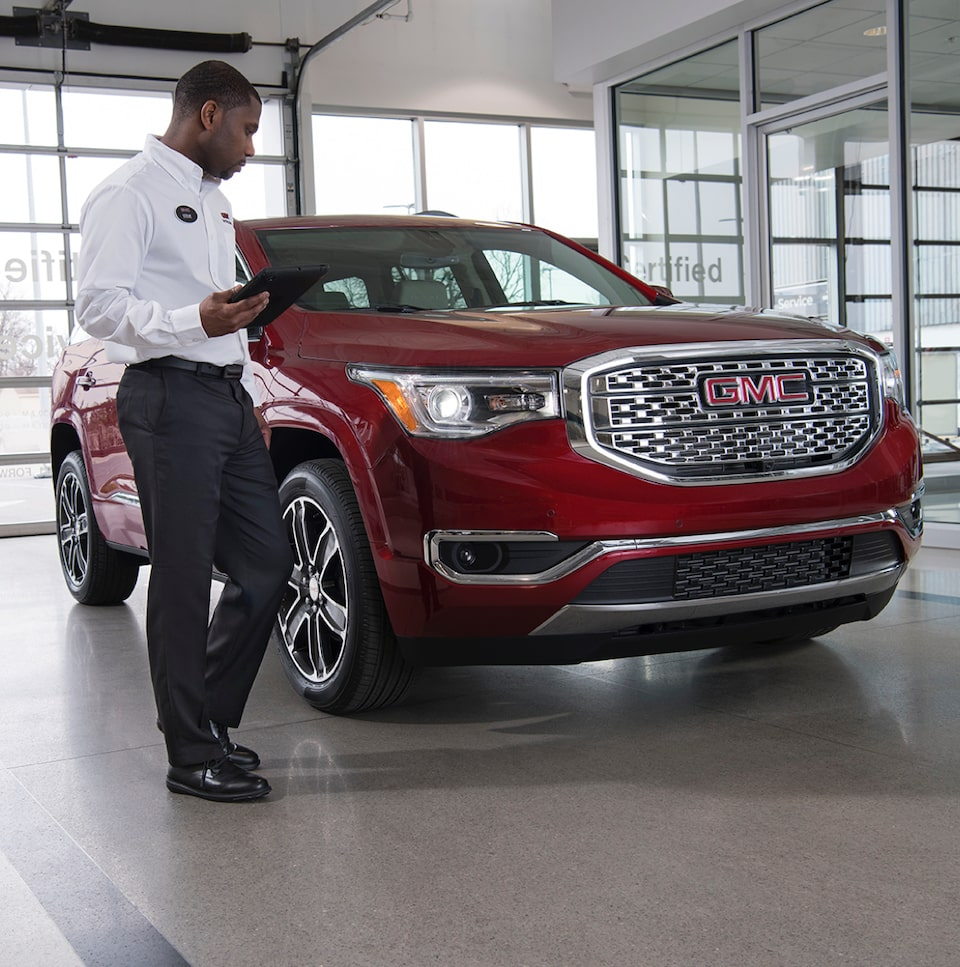 GMC Protection expert inspecting 2020 Terrain Denali Small SUV