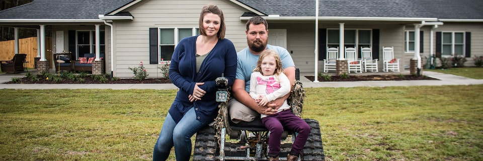 Image of a veteran and his family.