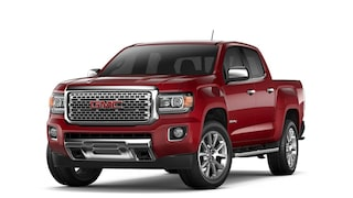 2017 Canyon Denali small pickup truck in red quartz tintcoat.