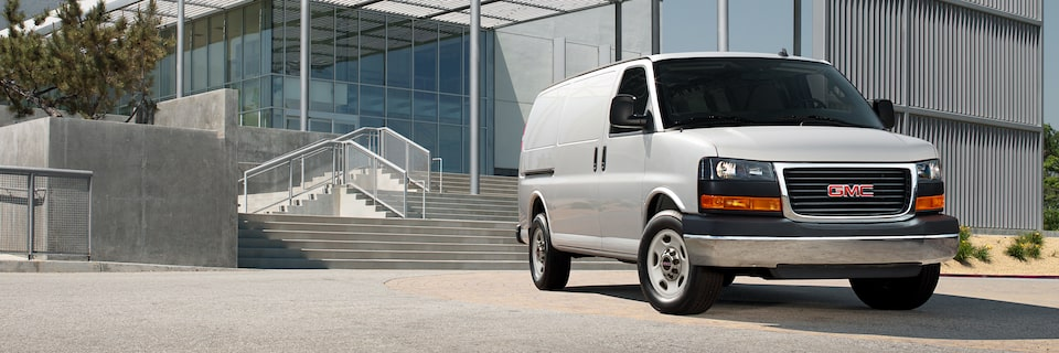 2020 GMC Savana Cargo Van outside modern building