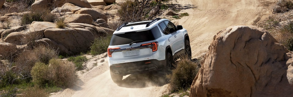 2020 GMC Acadia AT4 Mid-Size SUV: driving on a rocky terrain uphill