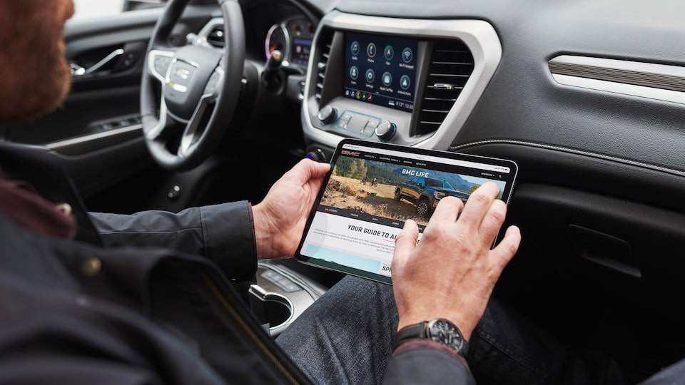 mobile device connected to the 4g Wi-Fi system in the 2020 GMC Acadia AT4 Mid-Size SUV