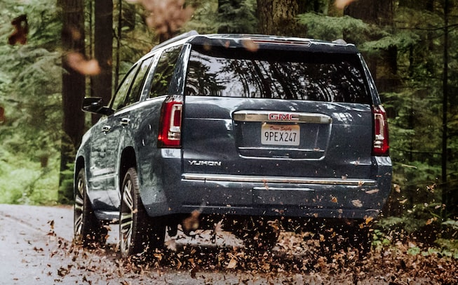2020 GMC Yukon Denali Ultimate full size SUV back view