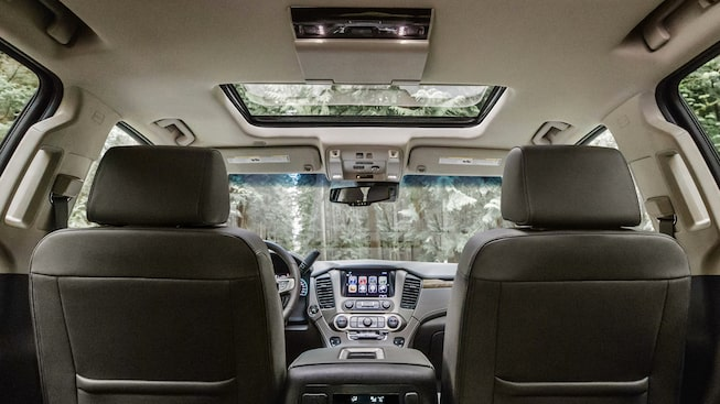 2020 GMC Yukon Denali full size SUV interior technology view from back seat for model details page
