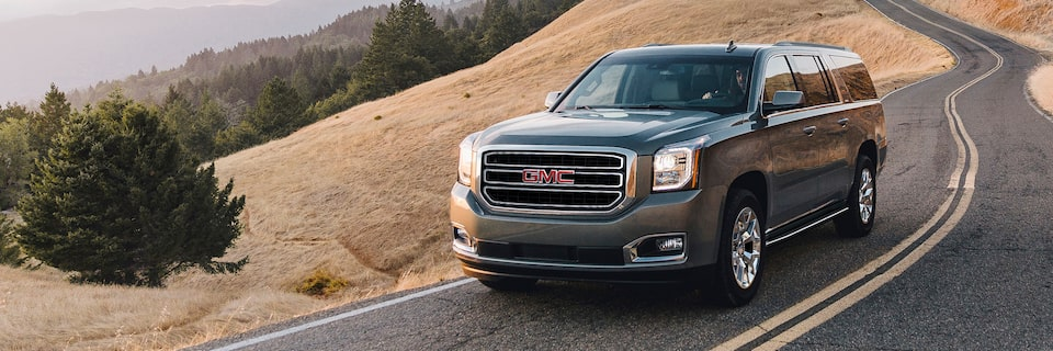 Masthead image for model details page featuring the 2020 GMC Yukon SLE-SLT Full size SUV