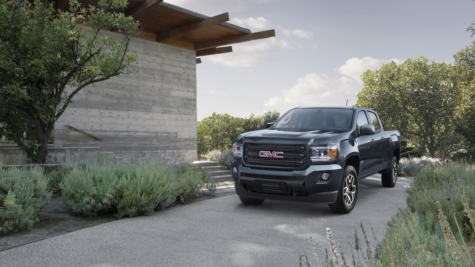 2020 GMC Canyon All Terrain Small Truck Road Less Traveled Next to House