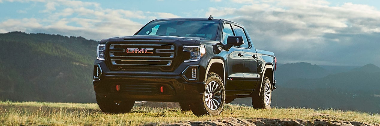 2020 GMC Sierra AT4 Off Road Truck in front of a mountain background