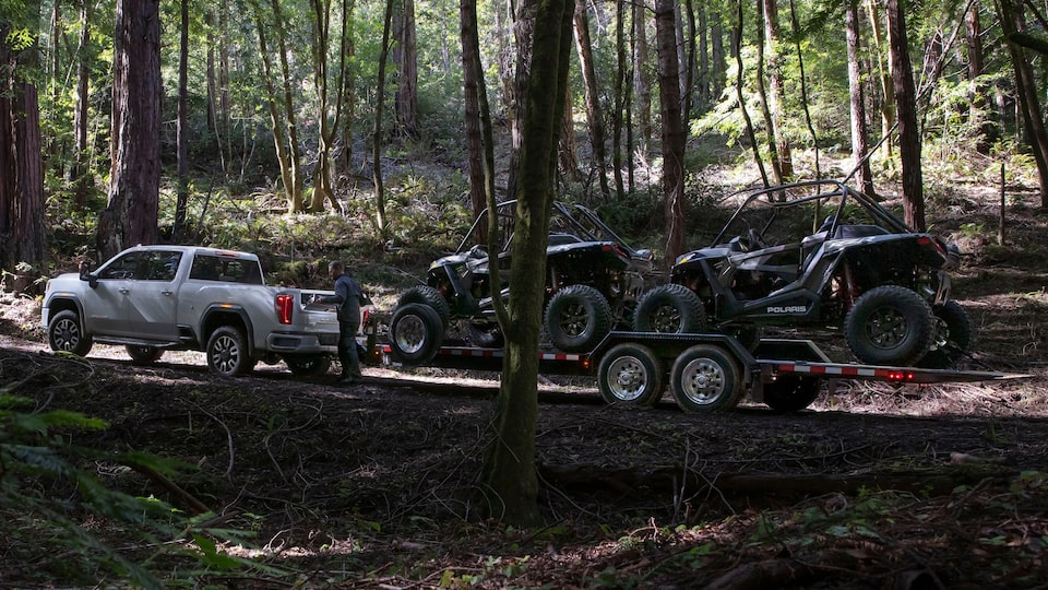 2020 GMC Sierra Heavy Duty Pickup Truck: towing two atvs in the woods