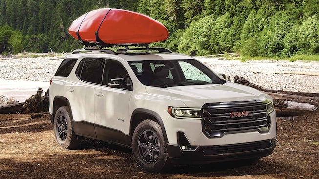 2021 GMC Acadia AT4 Off-road SUV Front Side View with Kayak on Roof