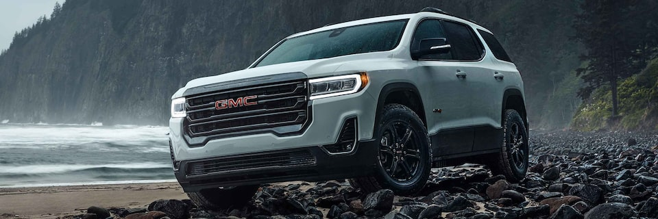 2021 GMC Acadia Mid-size SUV driving off-road