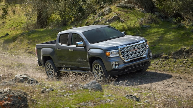 2021 GMC Canyon Denali Small Luxury Truck driving on dirt road