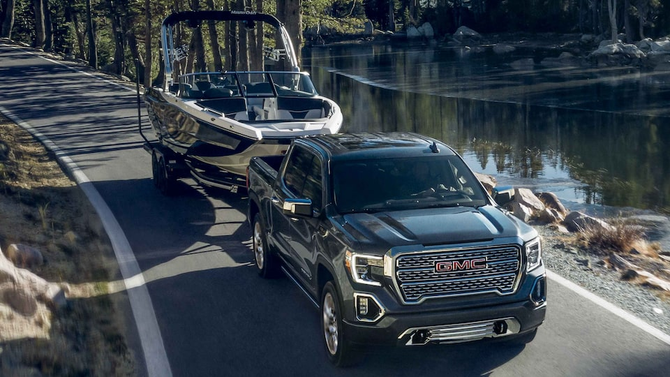 2021 GMC Sierra 1500 Denali Luxury Truck Towing Boat on Trailer