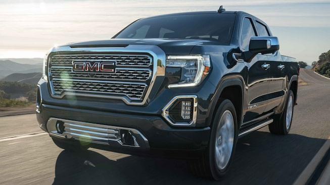 2021 GMC Sierra 1500 Denali Luxury Truck Driver Side View Driving