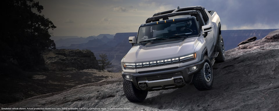 2020 GMC HUMMER EV Electric Truck driving off-road