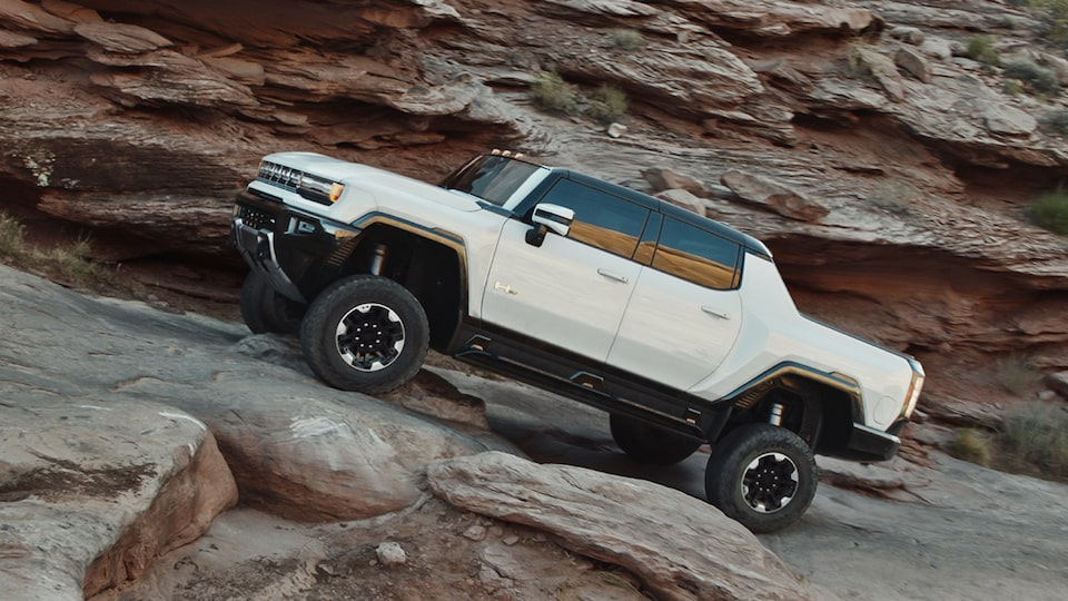 2020 GMC HUMMER EV Electric Truck Driving Up Hill