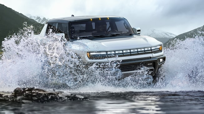 2020 GMC HUMMER EV Electric Truck driving through water