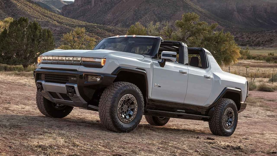 2021 GMC HUMMER EV Electric truck driving up hill