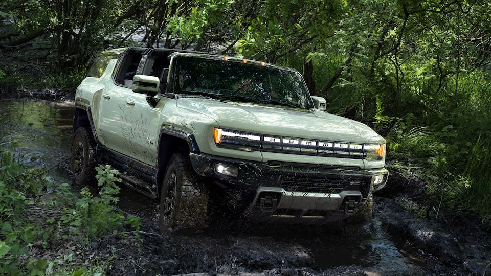 GMC HUMMER EV electric SUV driving off-road